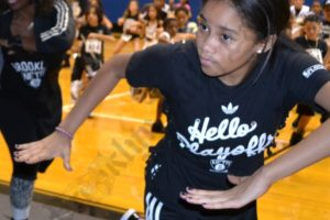 Christina DiMancha, a member of the 2012-13 Nets Kids Dance Team helps choreographer Tanisha Scott demonstrate dance moves to the auditioning kids. - Brooklyn Archive
