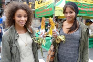 Girls with corn on the cob at the 2012 Atlantic Antic. - Brooklyn Archive