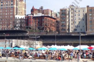 Lower Manhattan skyscrapers beckon, but on spring Sundays all the cool people are in Brooklyn Bridge Park eating Smorgasburg food. - Brooklyn Archive