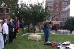 Marc Hermann demonstrating loading and firing rifle from the Civil War. - Brooklyn Archive