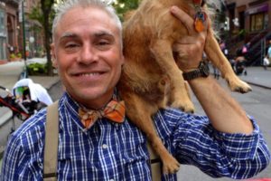 Peanut poses with his owner, George Jagatic, who was also the emcee of the fifth annual Montague Street Summer Space Dog Show. - Brooklyn Archive