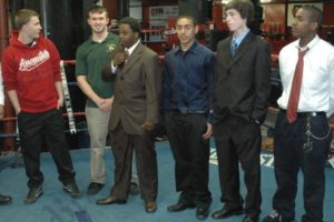 The eight young men from Brooklyn were sworn in at Gleason's Gym in the boxing ring, where the passing of the backpack tradition began. - Brooklyn Archive