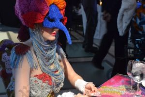 Tables were decorated with art installations – including one done by Brooklyn artist Olek (inset), where a mysterious masked woman sat. - Brooklyn Archive