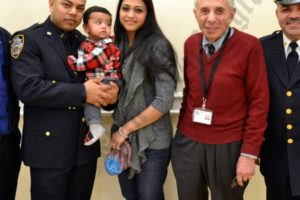 Captain Maximo Tolentino and Community Council President Leslie Lewis with 84th Precinct's 2013 Cop of the Year Saief Hasnain with his family — brother Samid Hasnain, wife Jerine Hasnain and son Ayan. - Brooklyn Archive