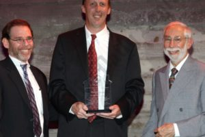 Honoree Martin Dunn (center) with Jeff Nemetsky and Ben Baxt. - Brooklyn Archive