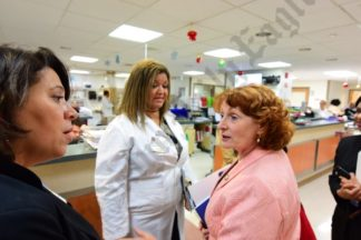 Assemblymember Jo Anne Simon asks questions during tour of TBHC emergency department. - Brooklyn Archive